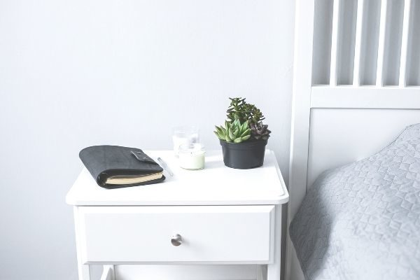 what to do at night by yourself, nightstand with journal
