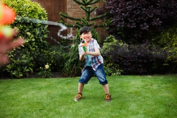 water gun fight to bring out your playful attitude