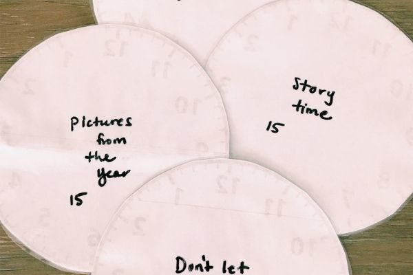 new year's eve family traditions - write on the back of the clocks for the countdown