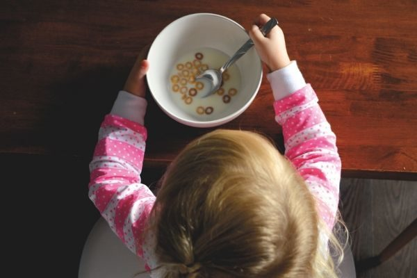 happy mom happy life. Girl eating cereal