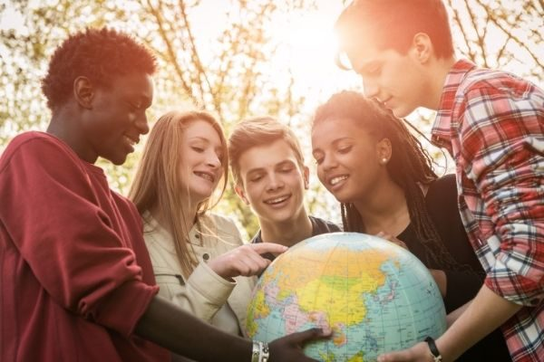 teens would you rather questions, tweens and teens holding a globe
