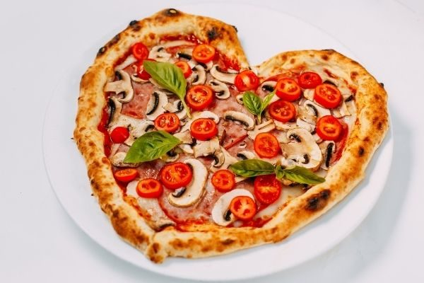 At-home date night Valentine's Day Ideas for couples: make or buy a heart pizza