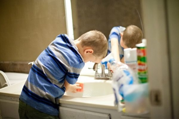 child using a bathroom cleaning checklist printable