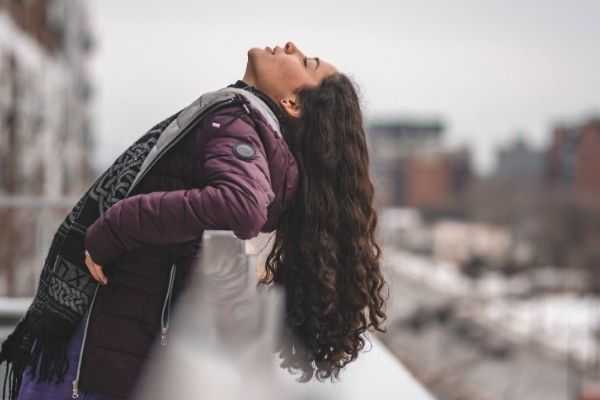 Woman on a ledge, don't give up quotes about growth mindset