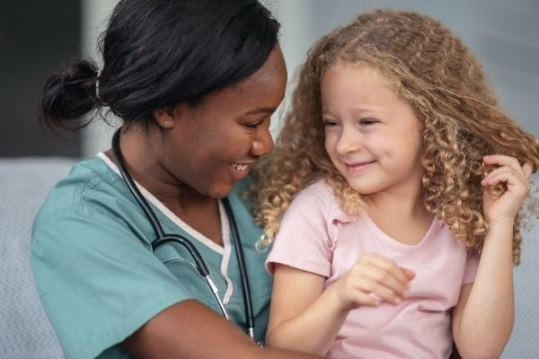 girl with medical professional: courage morning affirmations for kids