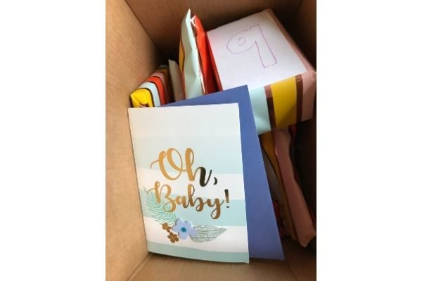 A card at the top of the new mommy care package