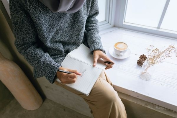 unexpected things to be grateful for: woman writing in journal 2021
