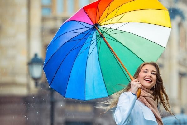 best 30 day wellness challenges, woman with umbrella