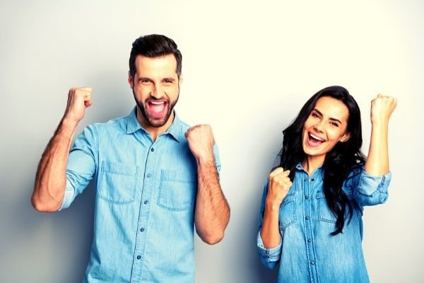 do 30 day challenges work? Man and woman pumping fists