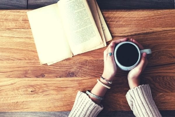 motivational good morning quotes, woman with coffee and inspirational book