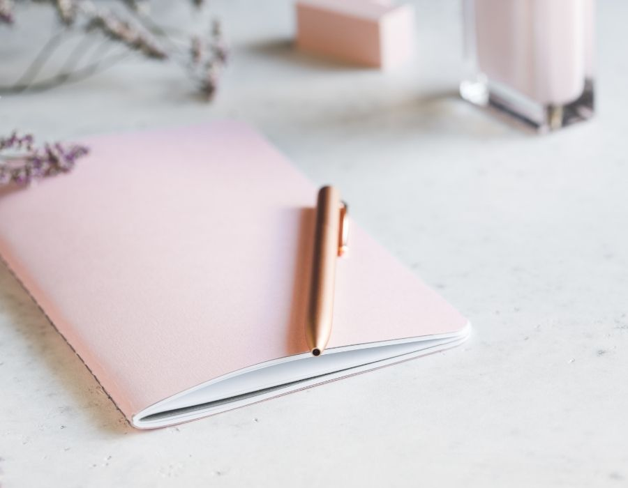 Journaling for self love with a pink journal and pen