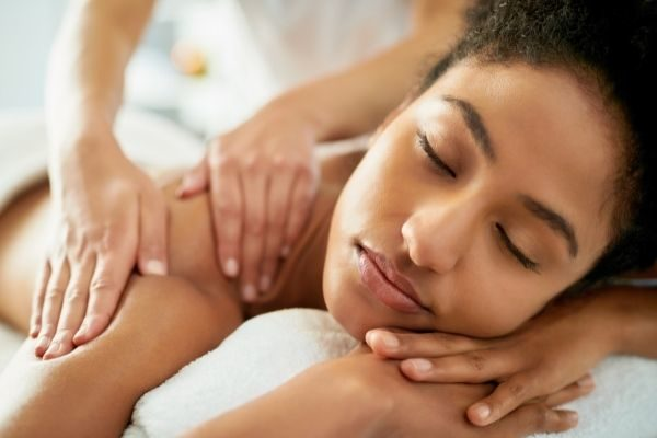 woman getting a massage: great Sunday self care ideas