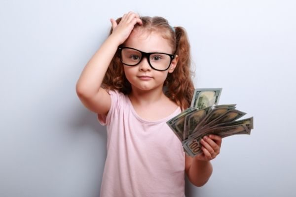 money makes for great conversation topics for kids: little girl with cash