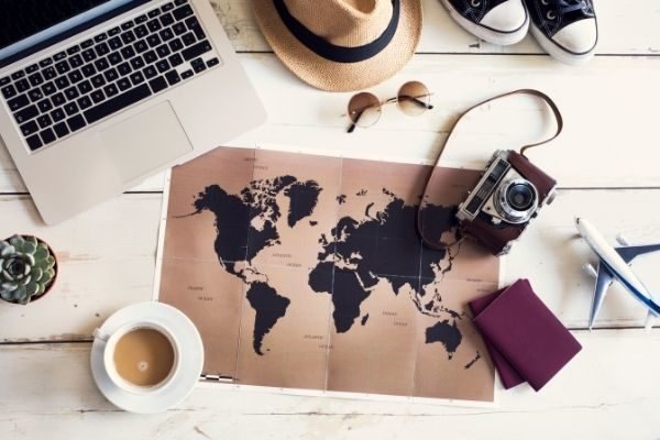 travel bucket list ideas and examples inspiration: map and computer