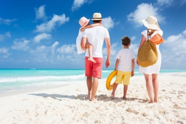 Vacations and travel for your family fun bucket list, family at the beach
